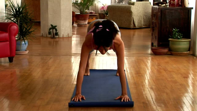 woman doing yoga - sun salutation stock videos and b-roll footage