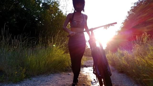 woman downhill mountain biker - crash helmet stock videos and b-roll footage