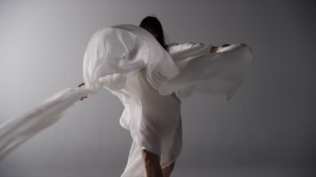 woman draped with silk backs away from camera - ballet dancing stock videos & royalty-free footage