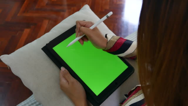 woman drawing on tablet pc in her home - digitized pen stock videos & royalty-free footage