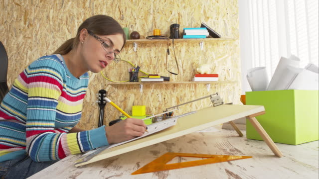 Woman drawing using drawing board