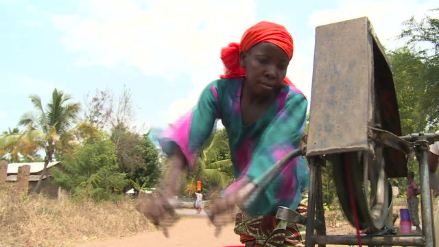 woman drawing water from a well - water pump stock videos & royalty-free footage