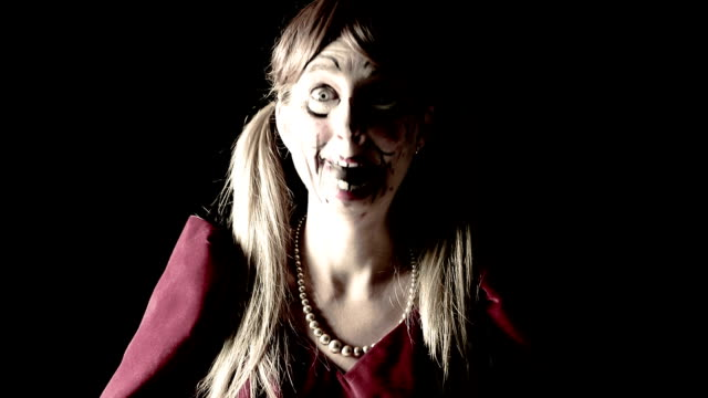 woman dressed as creepy doll laughing - ugliness stock videos & royalty-free footage