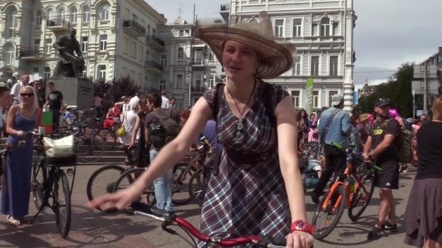 Woman dressed in clothes attend the bicycle parade named 'Kyiv Cycle Chic' in Kiev Ukraine on July 15 2017 Ukrainian women gathered with their...