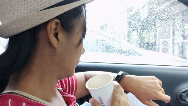 woman drink coffee and using smart watch in car shot on smart phone - coffee drink stock videos & royalty-free footage