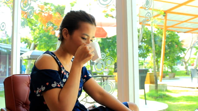 woman drink coffee with digital tablet - coffee drink stock videos & royalty-free footage