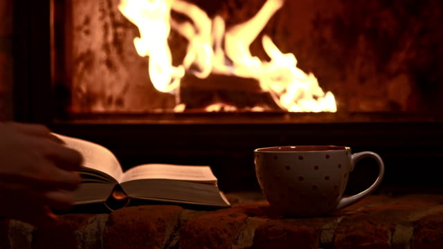 ds woman drinking a tea by the fireplace - chalet stock videos & royalty-free footage