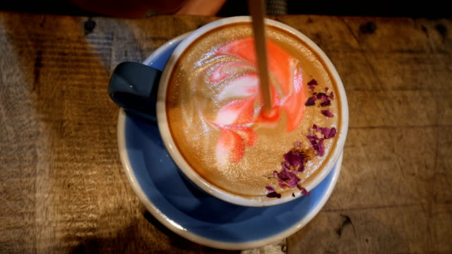 woman drinking a vegan capuccino in a new yorker coffee shop - almond milk stock videos & royalty-free footage