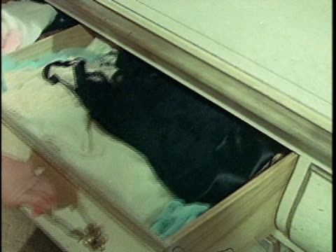 1971 MONTAGE Woman drinking alcohol hidden in dresser drawer, Los Angeles, California, USA, AUDIO