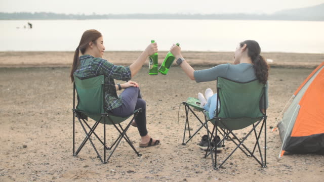 woman drinking beer on beach - refreshment stock videos & royalty-free footage