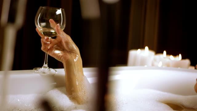 hd: woman drinking champagne in bubble bath - bubble bath stock videos & royalty-free footage