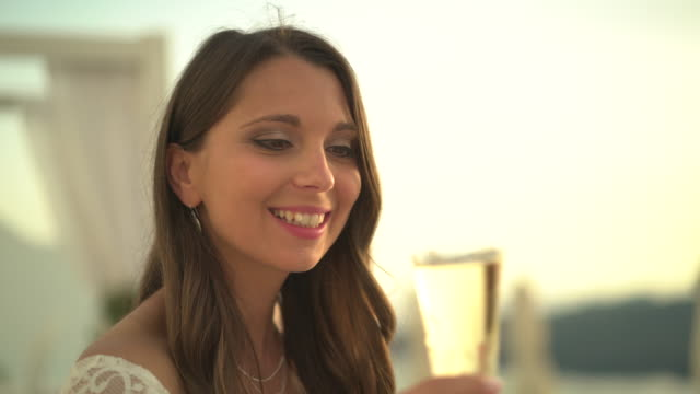 vidéos et rushes de woman drinking champange at sunset - millionnaire