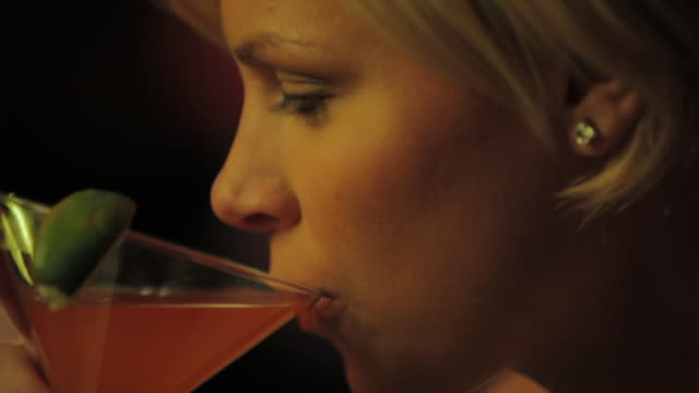 stockvideo's en b-roll-footage met cu woman drinking cocktail at bar / seattle, wa, united states - cocktail
