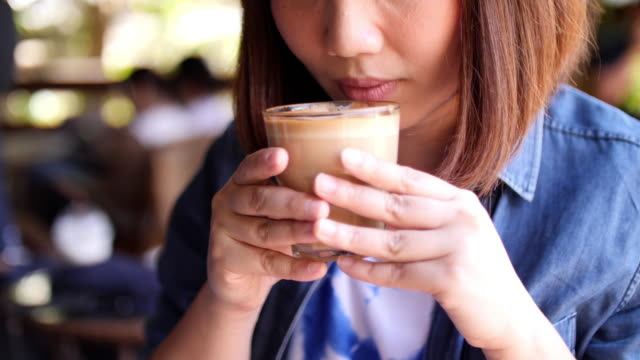 woman drinking coffee in coffee cafe , slow motion - coffee drink stock videos & royalty-free footage
