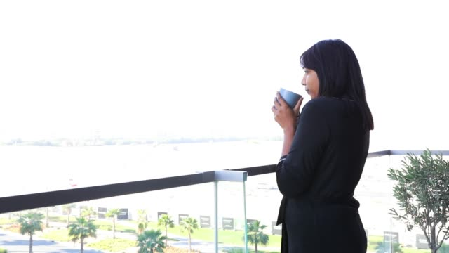 woman drinking coffee in the balcony - balcony stock videos & royalty-free footage
