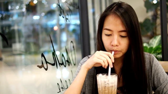 Woman drinking coffee in the cafe