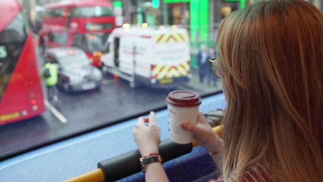 woman drinking coffee to go on a london bus - bus stock videos & royalty-free footage