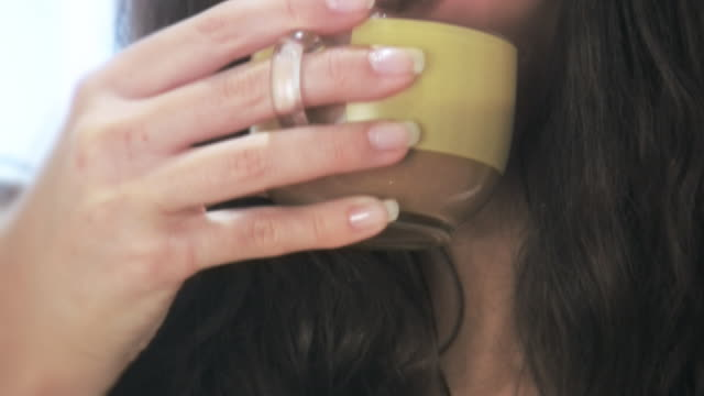 hd: woman drinking coffee - beautiful people stock videos & royalty-free footage