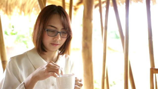 HD: woman drinking coffee.