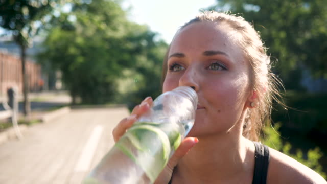 woman drinking cucumber water - antioxidant stock videos & royalty-free footage