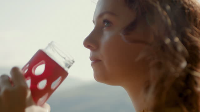 woman drinking from reusable glass bottle - bottle stock videos & royalty-free footage