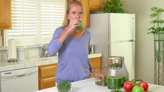 Woman drinking glass of juice