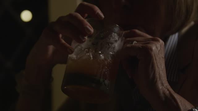 stockvideo's en b-roll-footage met woman drinking highball - martini