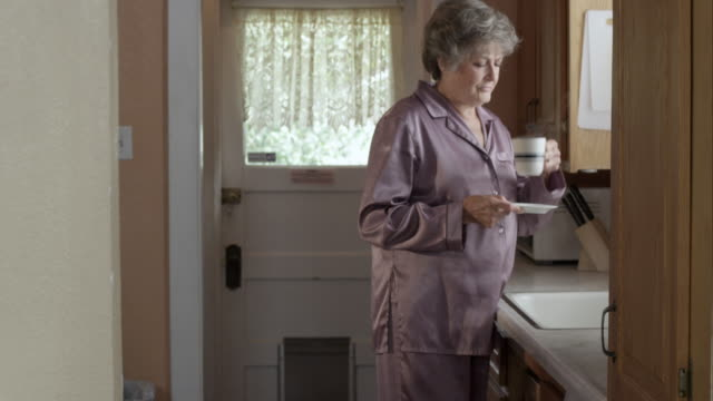 woman drinking hot beverage in pajamas. - tea hot drink stock videos & royalty-free footage