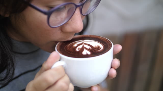 woman drinking hot cocoa - hot chocolate stock videos & royalty-free footage