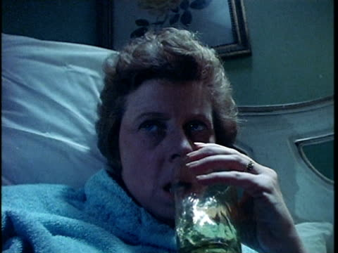 1971 MONTAGE Woman drinking in bed, husband asking for dinner, Los Angeles, California, USA, AUDIO