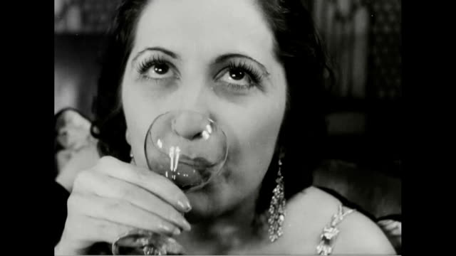 stockvideo's en b-roll-footage met woman drinking martini / man opening bottle of vat 69 whiskey, pouring for others / bartender with cocktail shaker / man drinking beer. - 1930