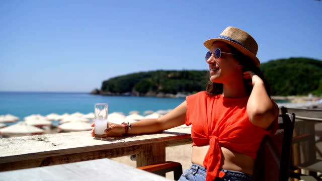woman drinking on beach terrace - patio stock videos & royalty-free footage