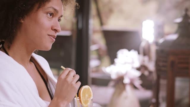 woman drinking orange juice at the spa - bathrobe stock videos & royalty-free footage