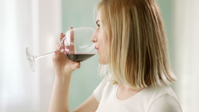 woman drinking red wine - wine glass stock videos and b-roll footage