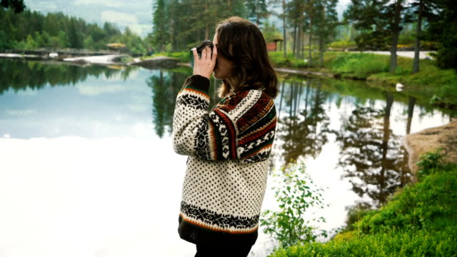 woman drinking tea near the lake in forest in norway - jumper stock videos & royalty-free footage