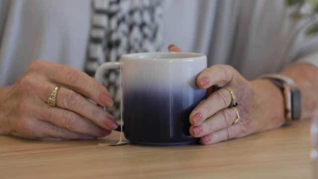 a woman drinking tea - mug stock videos & royalty-free footage