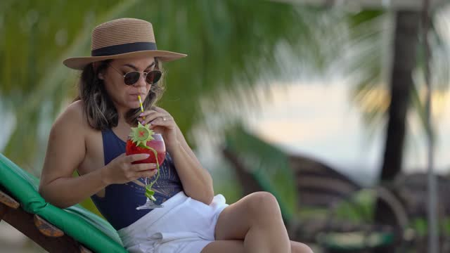 woman drinking tropical cocktail beach - tropical cocktail stock videos & royalty-free footage