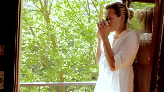 woman drinking - drinking tea stock videos and b-roll footage