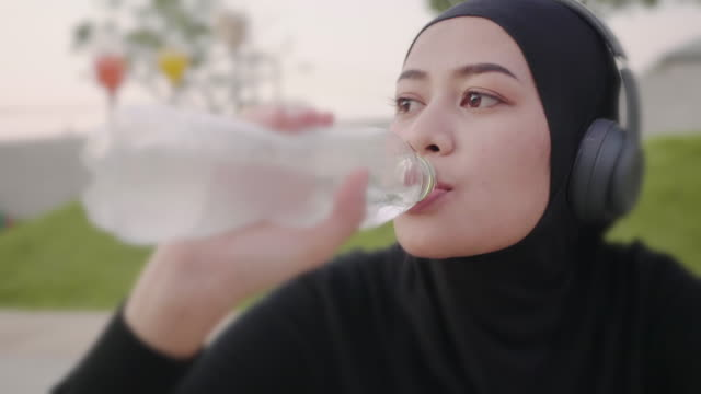 woman drinking water after exercise - drinking water stock videos & royalty-free footage