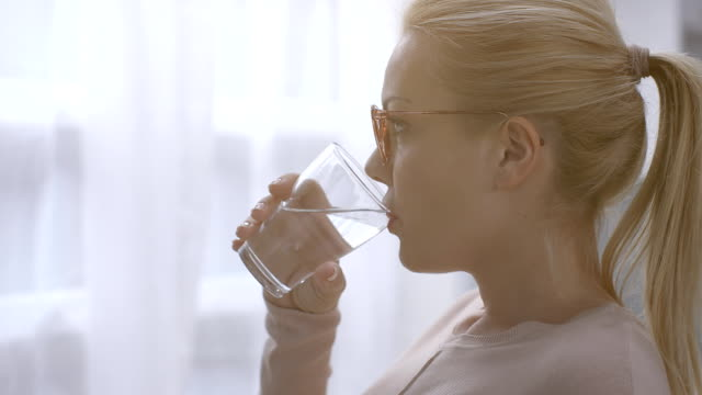woman drinking water - drink stock videos & royalty-free footage
