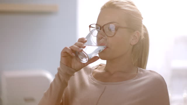 woman drinking water - drinking glass stock videos & royalty-free footage
