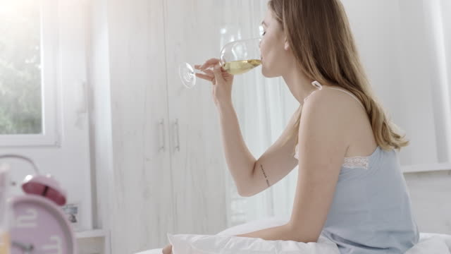 woman drinking wine in the bed - underwear stock videos & royalty-free footage