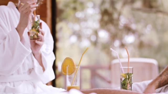 woman drinks refreshing drink at spa - bathrobe stock videos & royalty-free footage