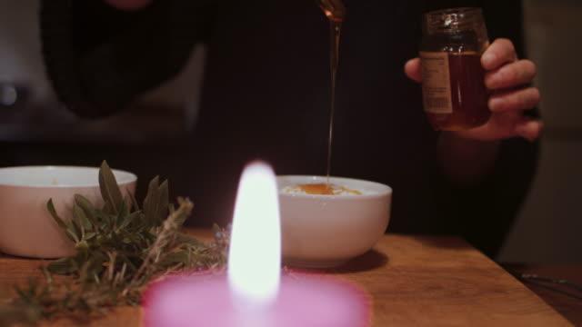 woman dripping and stirring honey into dessert - yoghurt stock videos & royalty-free footage
