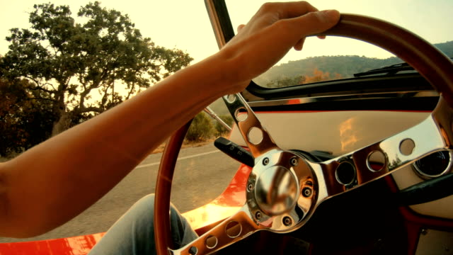 woman drives a car, close-up on hand - steering wheel stock videos & royalty-free footage