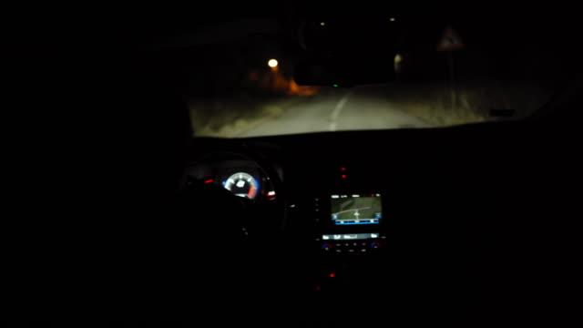 woman driving a car at night - global positioning system stock videos & royalty-free footage