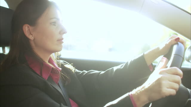 a woman driving a car sweden. - lenkrad stock-videos und b-roll-filmmaterial