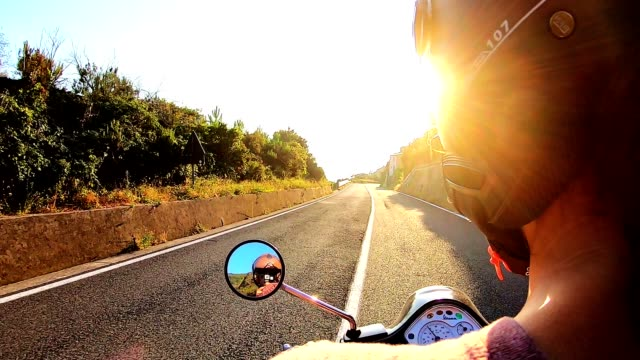 woman driving a motorbike at dusk - motocicletta video stock e b–roll