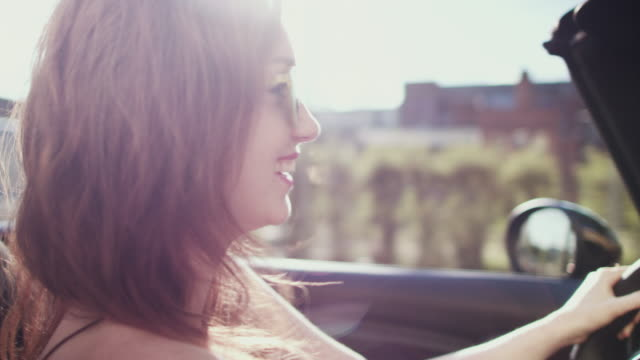 woman driving car - cabrio stock-videos und b-roll-filmmaterial