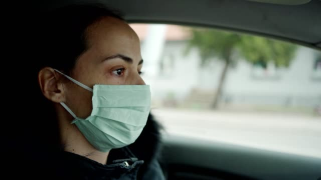 woman driving car with protective mask - driver occupation stock videos & royalty-free footage